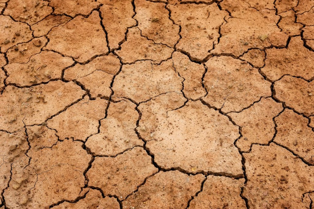 Dried earth representing droughts