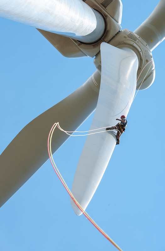 A person performing Wind Turbine maintainance in the UK